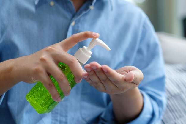 Man Sanitize His Hand by CBD Hand Sanitizer