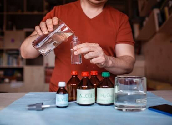 Man Making CBD Hand Sanitizer at Home