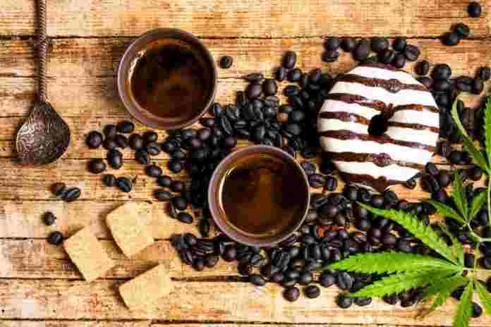 Cannabis Coffee with Donut and Cannabis Leaf On Coffee Beans