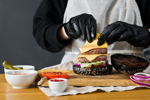 Man Making Weed Burger With Yellow Cheese And Black Burger Buns
