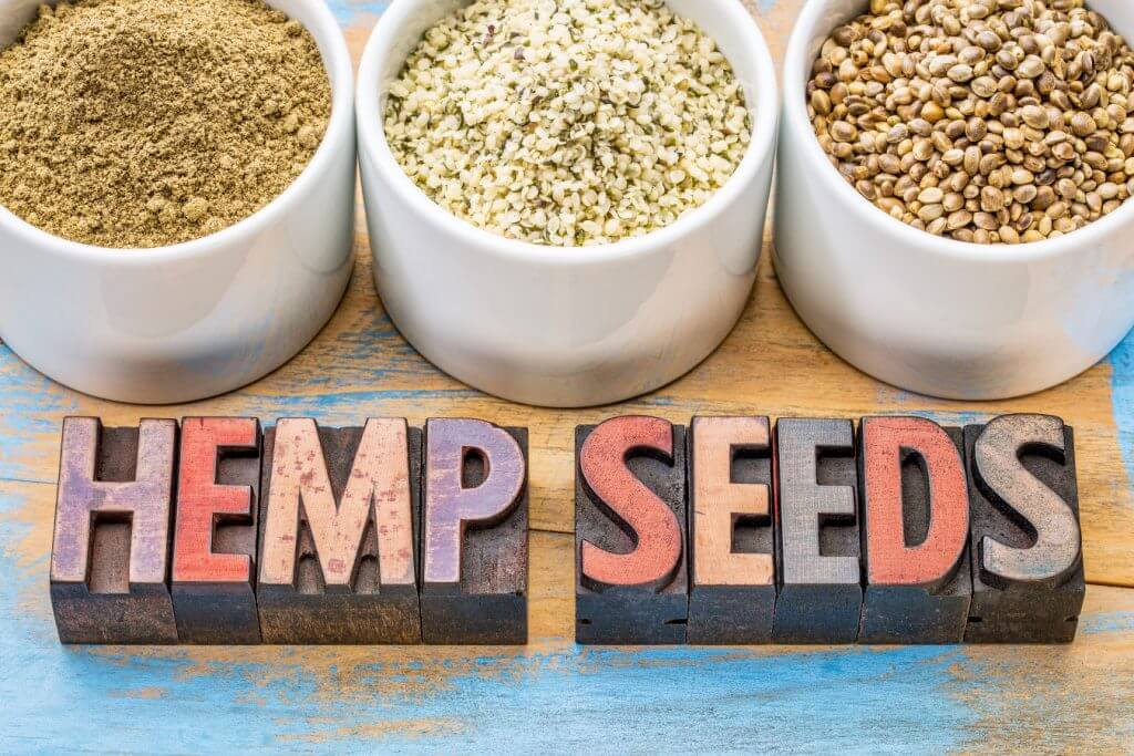 Hemp heart seeds in white bowls
