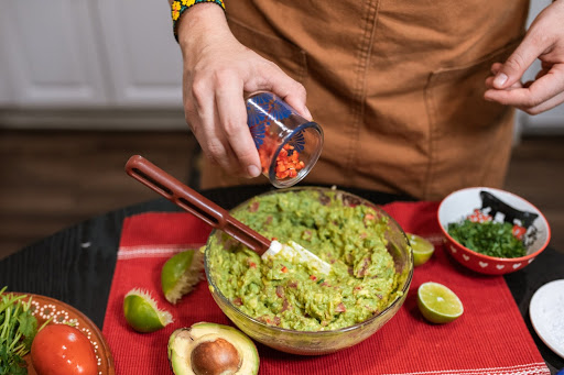 Woman making CBD infused guacamole