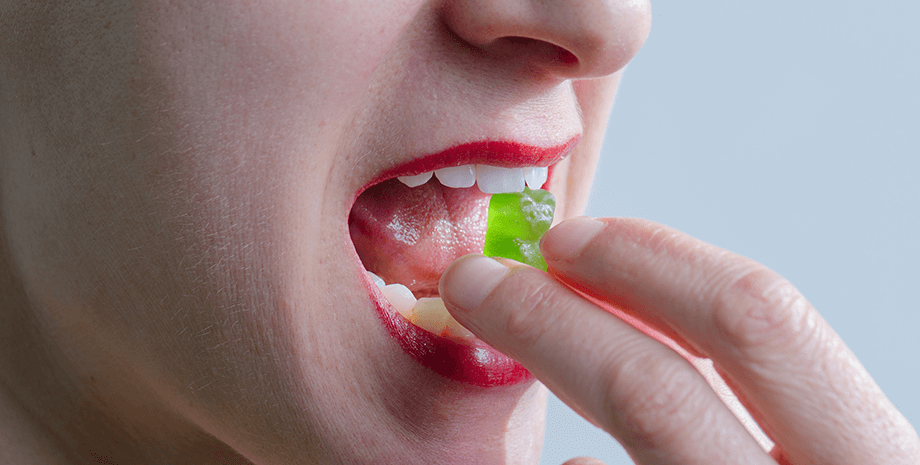 A lady consuming cannabis hard candy